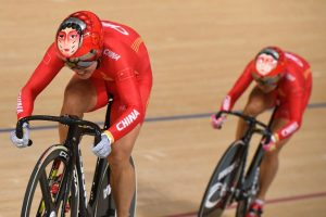 China's Zhong Tianshi (L) and China's Gong Jinjie compete in the women's Team Sprint finals track cycling event at the Velodrome during the Rio 2016 Olympic Games in Rio de Janeiro on August 12, 2016. / AFP PHOTO / Eric FEFERBERG
